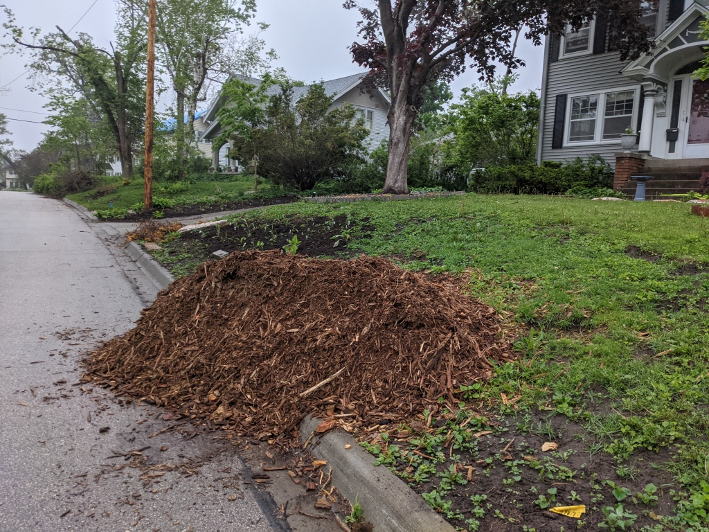 pile of mulch on a curb